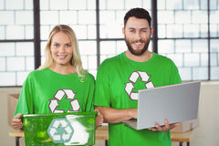Portrait of smiling volunteers in recycling symbol tshirts Stock Photography