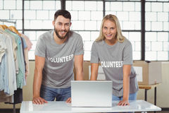 Portrait of smiling volunteers working on laptop Royalty Free Stock Photography