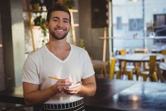 Portrait of smiling waiter taking order Royalty Free Stock Photos