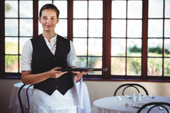 Portrait of smiling waitress holding a tray of coffee cup Royalty Free Stock Image