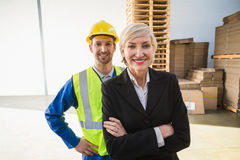 Portrait of smiling warehouse worker and his manager Stock Photo