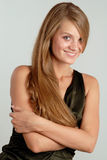 Portrait of smiling woman #2. Beautiful young smiling woman look on you.on lightgray background Stock Photography