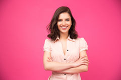 Portrait of a smiling woman with arms folded Stock Photos