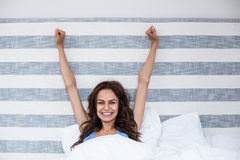 Portrait of smiling woman with arms raised Royalty Free Stock Images