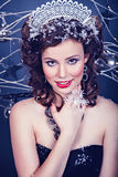 Portrait of smiling woman as Snow Queen character Stock Images