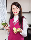 Portrait of smiling woman with avocado Royalty Free Stock Photography