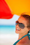 Portrait of smiling woman on beach Stock Photo