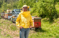 Portrait of smiling woman with beekeeping hat and veil. In the garden stock image