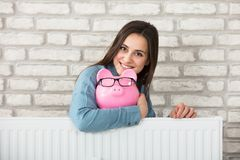 Woman Holding Piggy Bank Royalty Free Stock Images