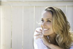 Portrait of a woman. Portrait of a smiling woman with blond hair Royalty Free Stock Photo