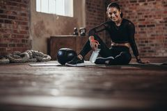 Female resting after exercise at fitness studio Stock Image