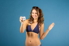 Portrait of  smiling woman with camera Stock Photography