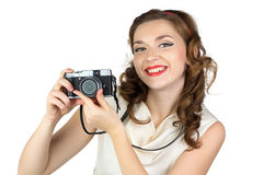 Portrait of the smiling woman with camera Royalty Free Stock Images