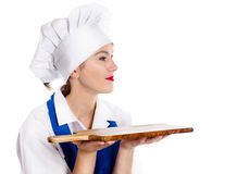 Portrait of smiling woman chef with cutting board Stock Images