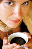 Portrait of smiling woman with coffee. Portrait of young woman with beautiful smile and a coffee stock photography