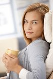 Portrait of smiling woman with coffee cup Stock Image