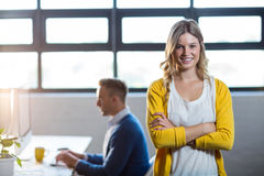 Portrait of smiling woman by colleague in office stock photos