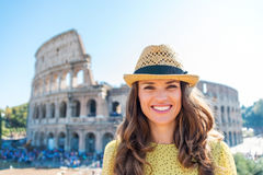 Portrait of smiling woman at Colosseum in Rome in summer Stock Images