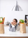 Portrait of a smiling woman cooking in her kitchen Stock Photos
