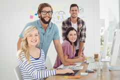 Portrait of smiling woman with coworkers Stock Image