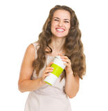 Portrait of smiling woman with cup of hot beverage Royalty Free Stock Images