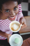 Portrait of smiling woman drinking cup of coffee Stock Photography
