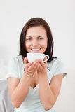 Portrait of a smiling woman drinking tea Royalty Free Stock Photo