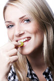 Portrait of a smiling woman eating a green grape Stock Photo