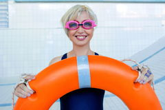 Portrait of smiling woman in the empty swimming pool Stock Photos