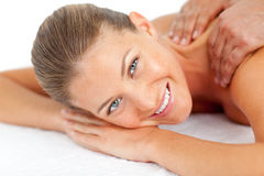 Portrait of smiling woman enjoying a massage. In a spa center Royalty Free Stock Image