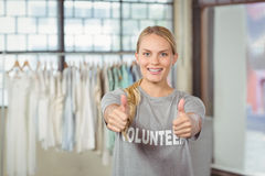 Portrait of smiling woman giving thumbs up Stock Images