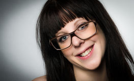 Portrait of smiling woman with glasses Royalty Free Stock Photos