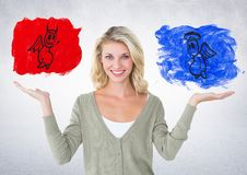 Portrait of smiling woman between good and bad conscience Stock Photography
