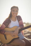 Portrait of smiling woman with guitar Stock Photography