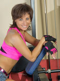 Portrait of smiling woman at gym Stock Photo
