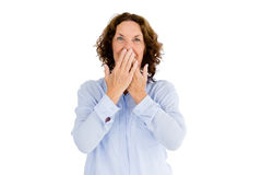 Portrait of smiling woman with hands covering mouth Stock Photo