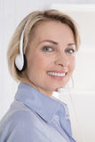 Portrait of smiling woman with headphone on telesales. royalty free stock photo
