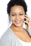 Smiling woman talking on her phone Stock Photography