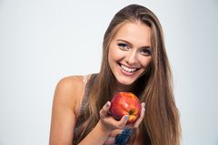 Portrait of a smiling woman holding apple Royalty Free Stock Image