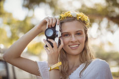 Portrait of smiling woman holding camera Stock Images