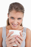 Portrait of a smiling woman holding a cup of tea Stock Images