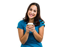 Portrait of smiling woman holding disposable coffee cup Royalty Free Stock Images