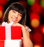 Portrait of a smiling woman holding gift boxes Stock Image