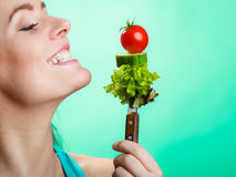 Portrait of smiling woman holding healthy food. Royalty Free Stock Image