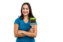 Portrait of smiling woman holding paint brush Royalty Free Stock Photo