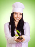 Portrait of smiling woman holding plant royalty free stock photography