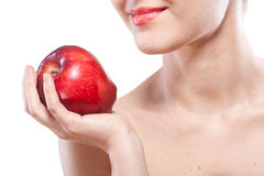 Portrait of smiling woman holding red apple Stock Images