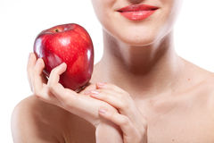 Portrait of smiling woman holding red apple Stock Photos