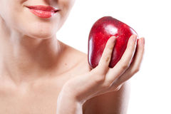 Portrait of smiling woman holding red apple isolated on white Royalty Free Stock Photography
