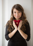 Portrait of smiling woman holding red knitted heart Royalty Free Stock Images